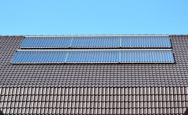 glazed solar collectors on roof above pool