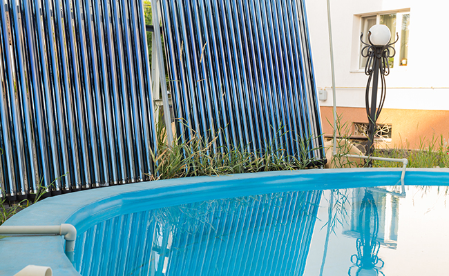 solar collectors on ground by pool