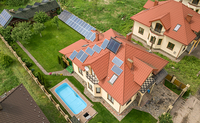 solar collectors on ground and roof