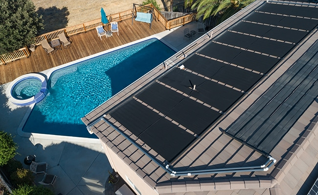 featured solar panels above pool